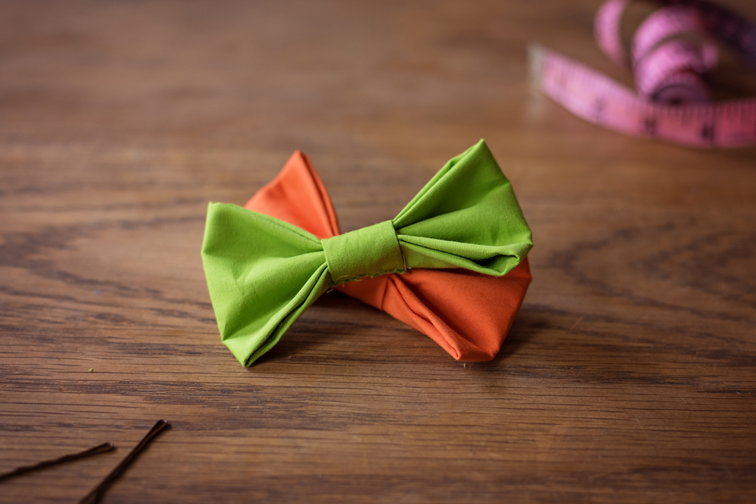 Green and orange bow ties