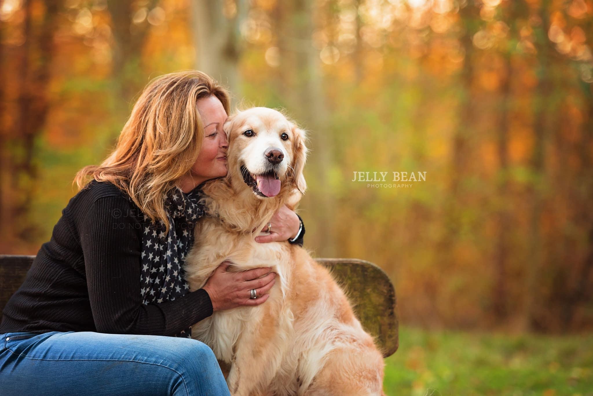 Woman hugging Golden Retriever