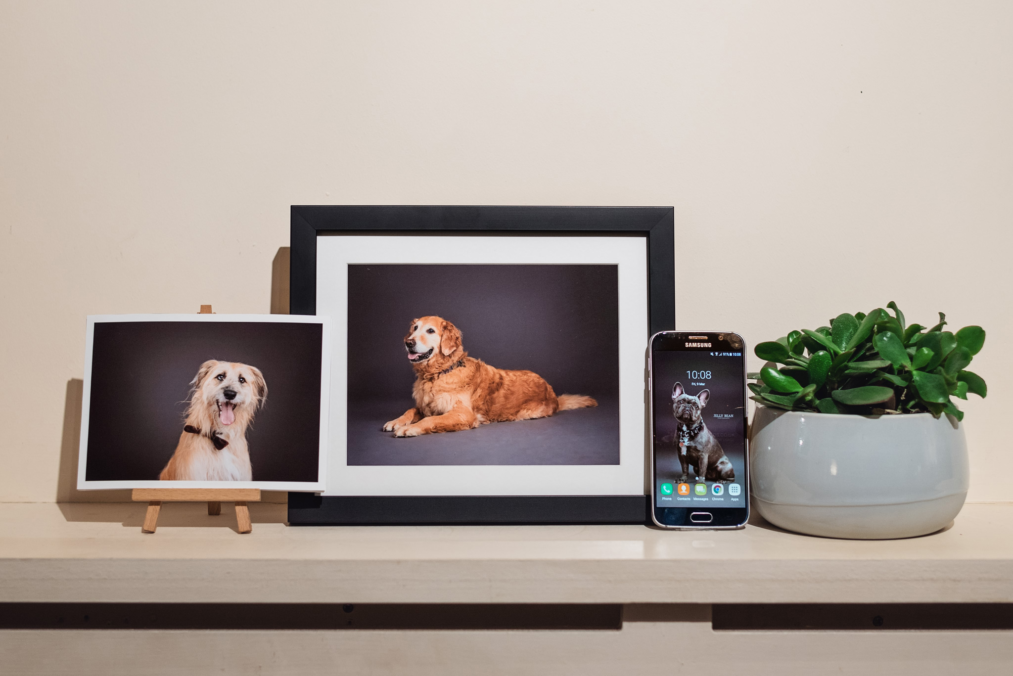 Framed desk print and fine art print on easel with digital image on phone background