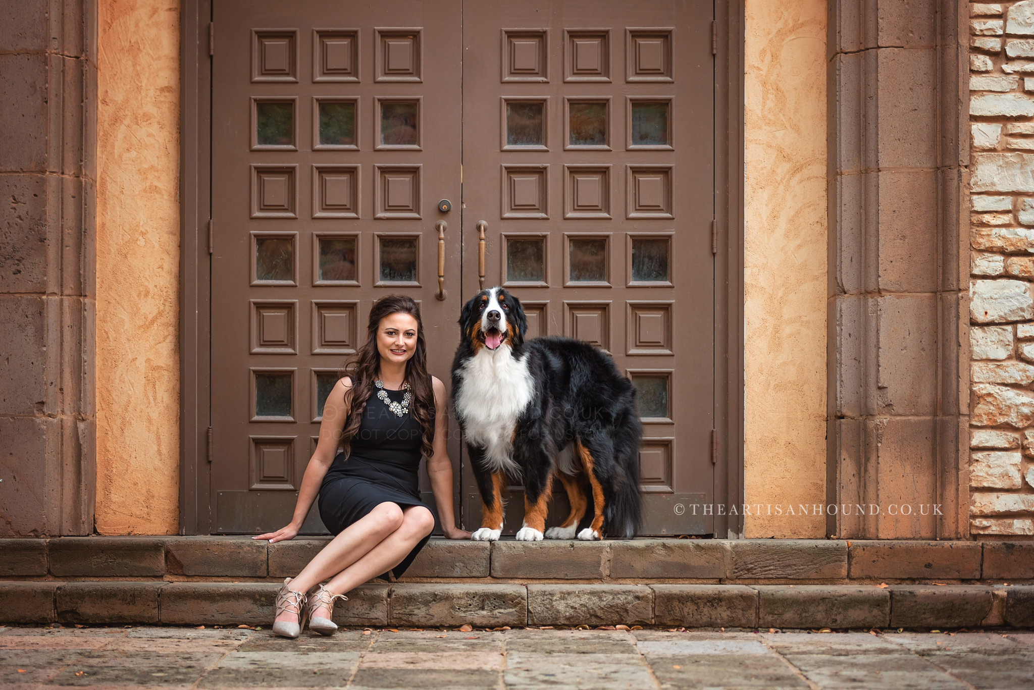 Bernese Mountain Dog standing in doorway with owner
