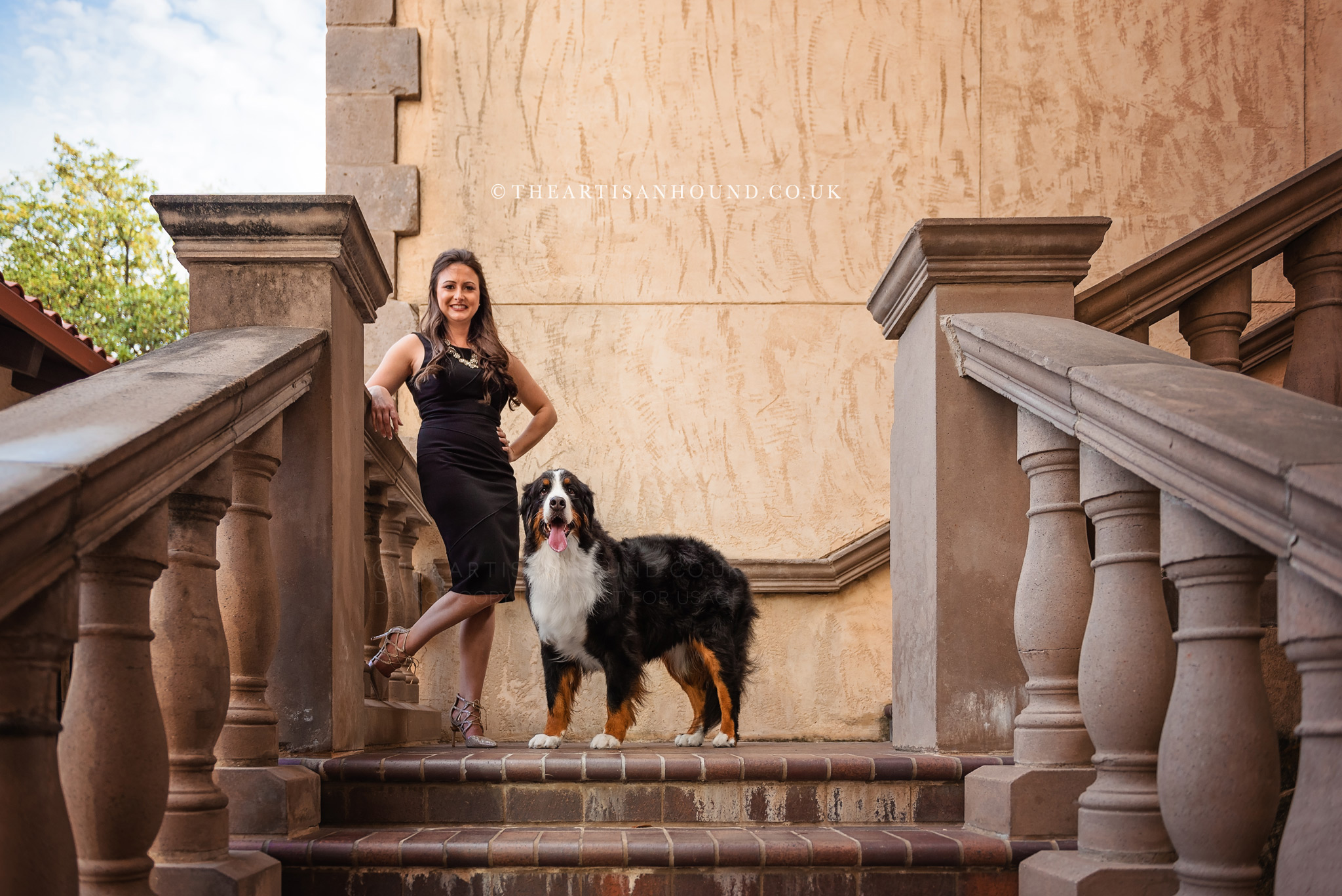 Dog and owner on staircase in Las Colinas canals