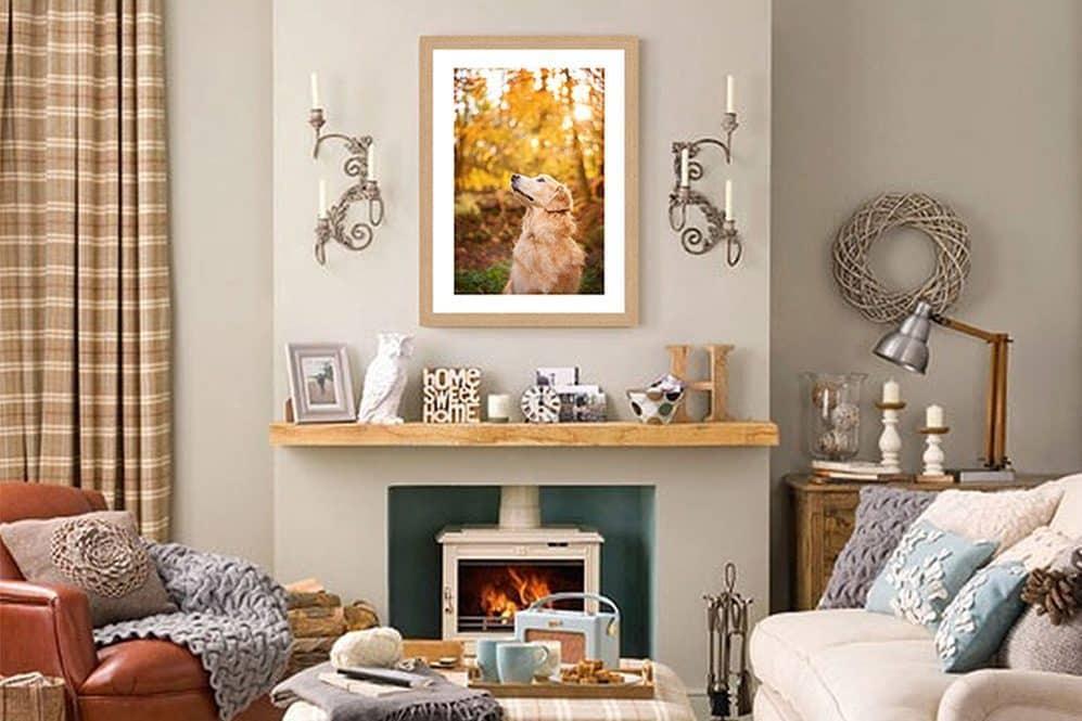 framed photo print above fireplace